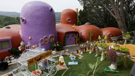 Flintstone House reaches yabba dabba deal: US homeowner can keep cartoon-inspired sculptures after settling lawsuit