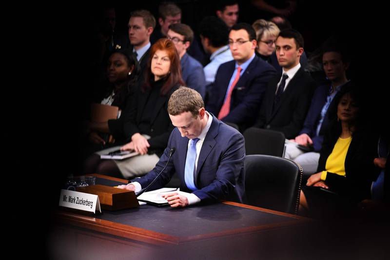 TOPSHOT - Facebook founder and CEO Mark Zuckerberg testifies during a Senate Commerce, Science and Transportation Committee and Senate Judiciary Committee joint hearing about Facebook on Capitol Hill in Washington, DC, April 10, 2018. Facebook chief Mark Zuckerberg apologized to US lawmakers Tuesday for the leak of personal data on tens of millions of users as he faced a day of reckoning before a Congress mulling regulation of the global social media giant.In his first-ever US congressional appearance, the Facebook founder and chief executive sought to quell the storm over privacy and security lapses at the social network that have angered lawmakers and Facebook's two billion users.  / AFP PHOTO / JIM WATSON