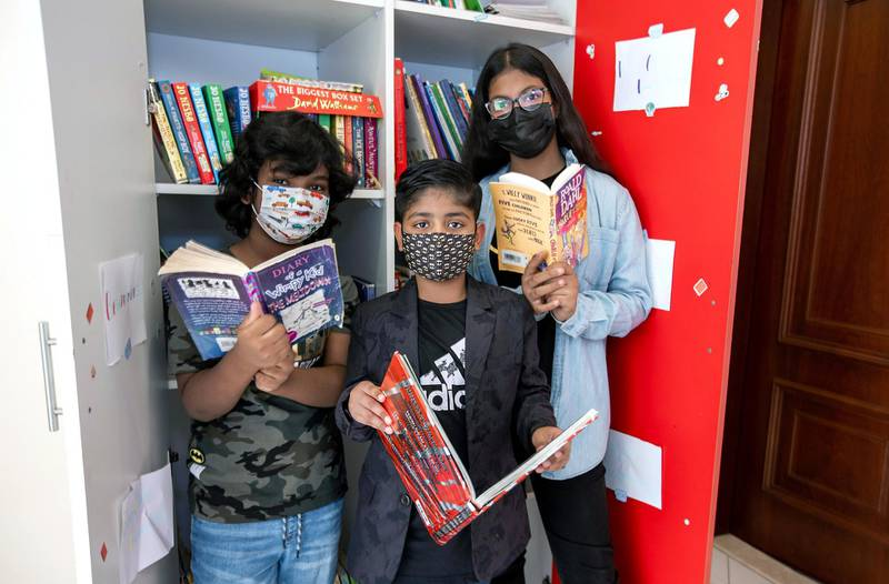 Ayaan Tariq, 7, with friends, Ayesha, 10, and Mohammad, 8, at his library which was once a maids quarters. Victor Besa / The National.Reporter: Anam Rizi for News