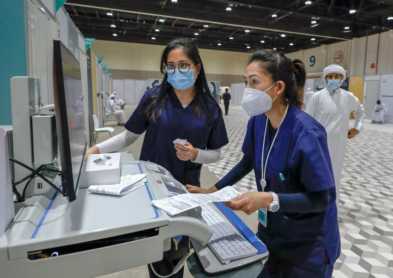 Abu Dhabi, United Arab Emirates, August 6, 2020.  Nurses update some records at the ADNEC volunteer facility. Victor Besa /The NationalSection: NAReporter:  Shireena Al Nowais