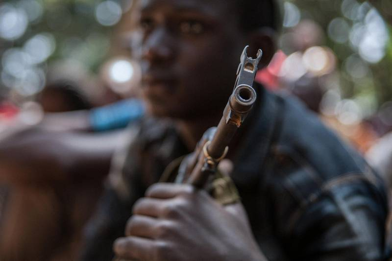 A newly released child soldier attends a release ceremony in Yambio, South Sudan, on February 7, 2018. - More than 300 child soldiers, including 87 girls, have been released in South Sudan's war-torn region of Yambio under a programme to help reintegrate them into society, the UN said on on Februar y 7, 2018. A conflict erupted in South Sudan little more than two years after gained independence from Sudan in 2011, causing tens of thousands of deaths and uprooting nearly four million people. The integration programme in Yambio, which is located in the south of the country, aims at helping 700 child soldiers return to normal life. (Photo by Stefanie Glinski / AFP)