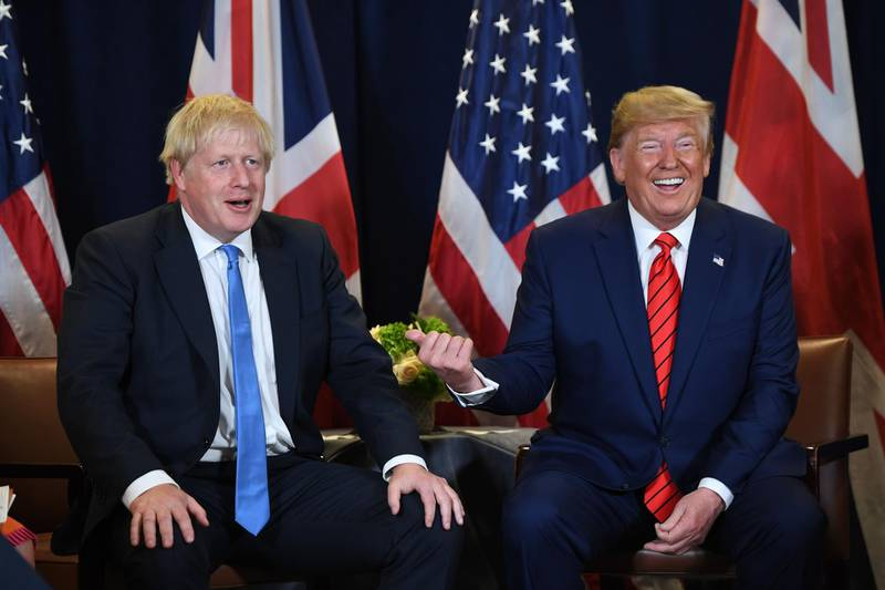 (FILES) In this file photo taken on September 24, 2019 US President Donald Trump and British Prime Minister Boris Johnson hold a meeting at UN Headquarters in New York, September 24, 2019, on the sidelines of the United Nations General Assembly. US President Donald Trump flies into Britain next week, just days before its general election -- and if earlier visits are any guide, fireworks are expected. Trump is in town for a summit marking 70 years of the NATO military alliance, but his presence risks disrupting the campaign for the December 12 vote as it enters the final straight.  / AFP / SAUL LOEB