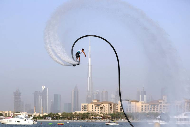 Dubai, United Arab Emirates - Reporter: N/A. Sport. People compete in the fly board section of the Dubai Watersports Summer Week. Thursday, June 25th, 2020. Dubai. Chris Whiteoak / The National