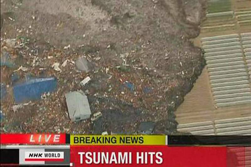 A tsunami carries buildings (bottom) across water in Sendai in this still image taken from video footage March 11, 2011. A massive 8.9 magnitude quake hit northeast Japan on Friday, causing many injuries, fires and a four-metre (13-ft) tsunami along parts of the country's coastline, NHK television and witnesses reported.  REUTERS/NHK via Reuters TV (JAPAN - Tags: DISASTER ENVIRONMENT) NO SALES. NO ARCHIVES. FOR EDITORIAL USE ONLY. NOT FOR SALE FOR MARKETING OR ADVERTISING CAMPAIGNS. THIS IMAGE HAS BEEN SUPPLIED BY A THIRD PARTY. IT IS DISTRIBUTED, EXACTLY AS RECEIVED BY REUTERS, AS A SERVICE TO CLIENTS. TEMPLATE OUT. JAPAN OUT. NO COMMERCIAL OR EDITORIAL SALES IN JAPAN *** Local Caption ***  SIN78_JAPAN-QUAKE-_0311_11.JPG