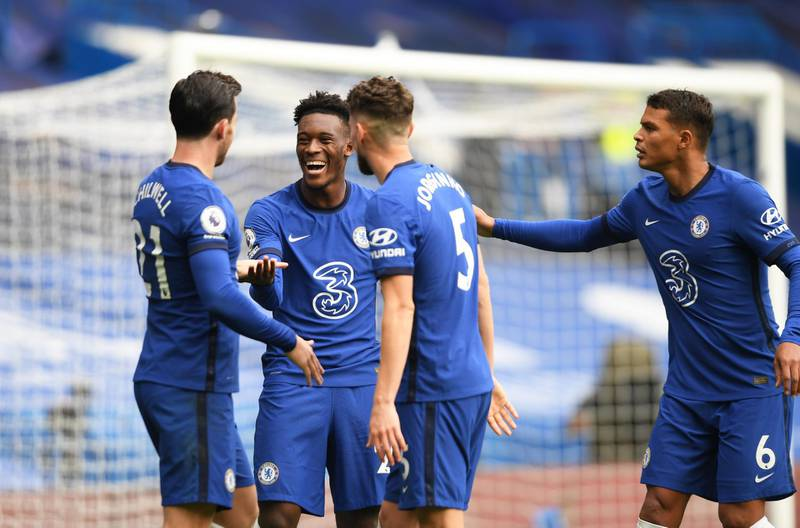 LONDON, ENGLAND - OCTOBER 03: Ben Chilwell of Chelsea celebrates with teammates Callum Hudson-Odoi, Jorginho and Thiago Silva after scoring his sides first goal during the Premier League match between Chelsea and Crystal Palace at Stamford Bridge on October 03, 2020 in London, England. Sporting stadiums around the UK remain under strict restrictions due to the Coronavirus Pandemic as Government social distancing laws prohibit fans inside venues resulting in games being played behind closed doors. (Photo by Mike Hewitt/Getty Images)