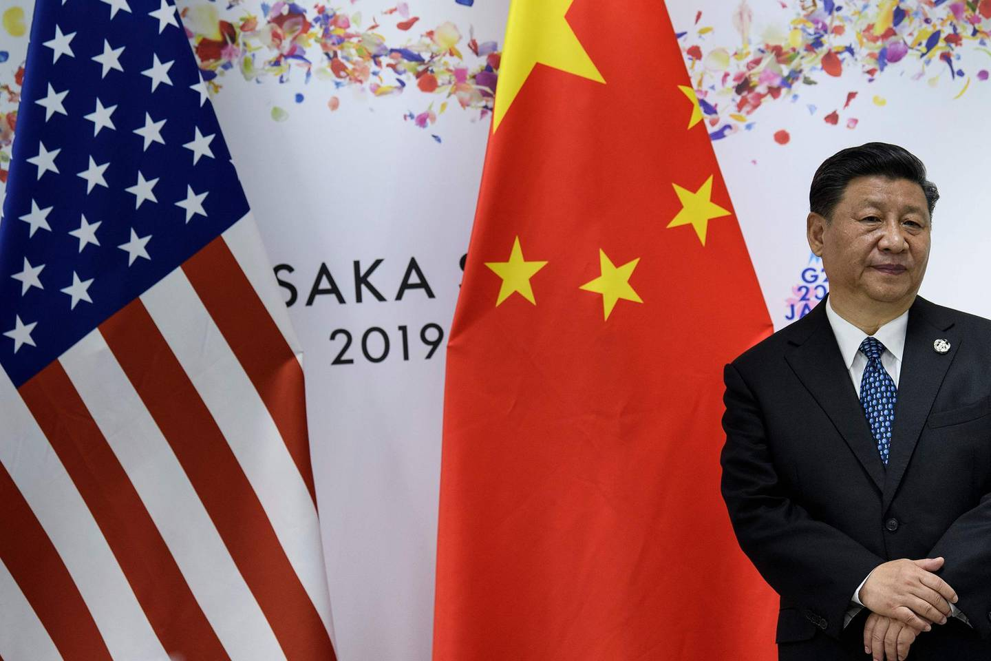 China's President Xi Jinping waits for a meeting with US President Donald Trump (not pictured) on the sidelines of the G20 Summit in Osaka on June 29, 2019. / AFP / Brendan Smialowski