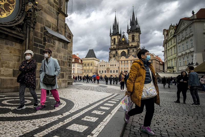 PRAGUE, CZECH REPUBLIC - MARCH 12: Tourists wearing face masks are seen at the Old Town Square on March 12, 2020 in Prague, Czech Republic. The government of the Czech Republic has declared a 30-day state of emergency due to the coronavirus outbreak. Czech Ministry of Health confirmed several dozens cases of COVID -19 on March 12, 2020 in the Czech Republic. (Photo by Gabriel Kuchta/Getty Images)
