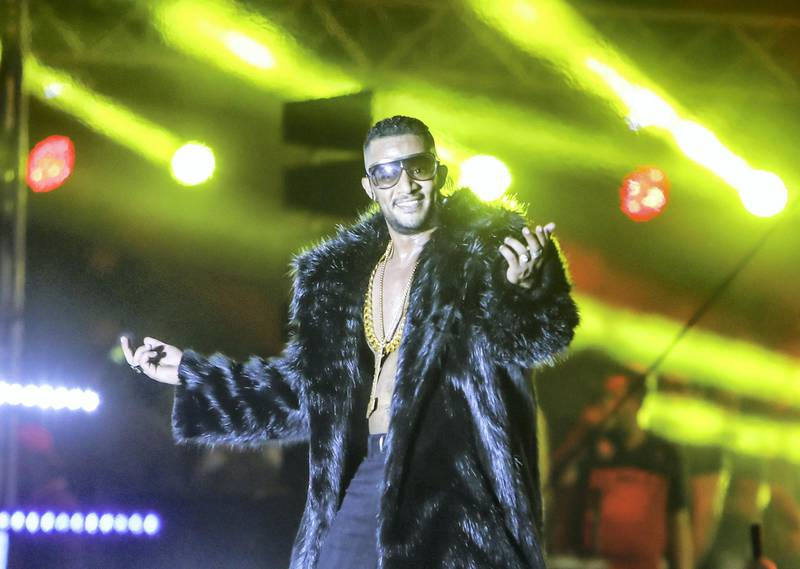 epa07792503 Egyptian actor and singer Mohamed Ramadan performs during a concert at a resort in the North Coast, Egypt, 23 August 2019 (issued 25 August 2019).  EPA-EFE/MAHMOUD AHMED *** Local Caption *** 55415984