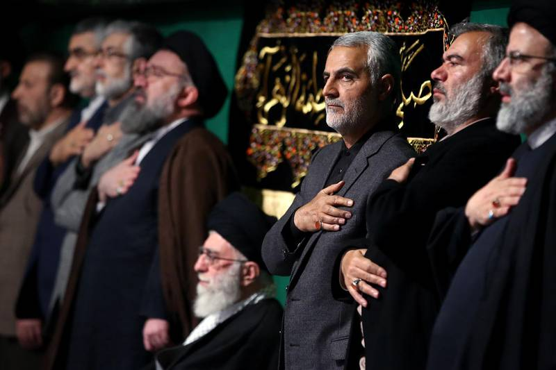 (FILES) In this file handout photo released on March 27, 2015 by the official website of the Centre for Preserving and Publishing the Works of Iran's supreme leader Ayatollah Ali Khamenei, shows him (C) with the commander of the Iranian Revolutionary Guard's Quds Force, Gen. Qasem Soleimani (3rd from R), attending a religious ceremony in Tehran to commemorate the anniversary of the death of the daughter of Prophet Mohammed. Top Iranian commander Qasem Soleimani was killed in a US strike on Baghdad's international airport on January 3, 2020, Iraq's powerful Hashed al-Shaabi paramilitary force has said, in a dramatic escalation of tensions between Washington and Tehran. / AFP / KHAMENEI.IR / HO