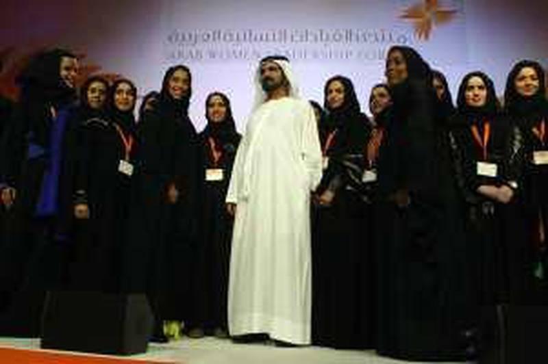 DUBAI, UNITED ARAB EMIRATES - JANUARY 12:  Sheikh Mohammed bin Rashid Al Maktoum, the Prime Minister and Vice President of the United Arab Emirates (UAE), and Ruler of Dubai, in attendance on the first day of the Arab Women Leadership Forum held at the Grand Hyatt Hotel in Dubai on January 12, 2010. Also pictured is Mona Al Marri (centre left), Chief Executive Officer, Brand Dubai.  (Randi Sokoloff / The National)  For News story by Zoi Constantine *** Local Caption ***  RS007-011210-ARAB-WOMEN.jpg