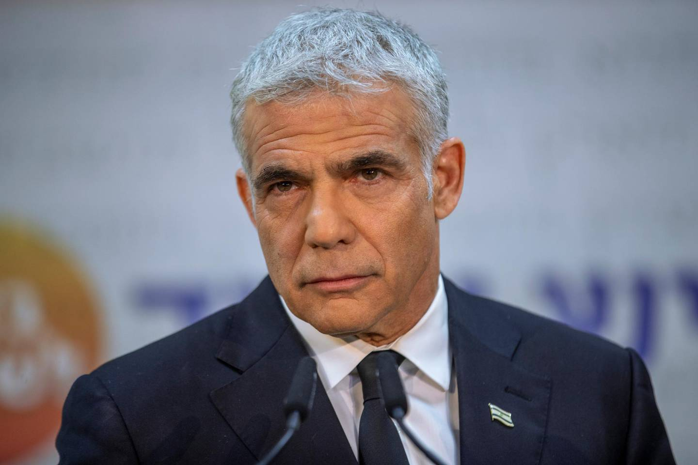 FILE - In this May 6, 2021, file photo, Israeli opposition leader Yair Lapid listens during a news conference in Tel Aviv, Israel. Prime Minister Benjamin Netanyahu's opponents on Wednesday, June 2, were racing to finalize a coalition government to end his 12-year rule — the longest by any Israeli premier — ahead of a midnight deadline. Centrist Lapid and ultranationalist Naftali Bennett have joined forces and agreed to rotate the premiership between them, with Bennett going first, but are still working to cobble together a ruling coalition that would include parties from across the political spectrum. (AP Photo/Oded Balilty, File)