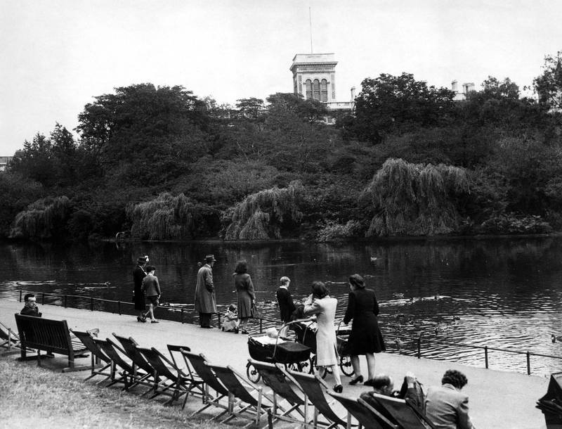 St James's Park, showing the lake and the Island Bird Sanctuary. It has been announced that Mr Hugh Edmund Watts, Chief Inspector of Explosives at the Home Office, has been awarded the George Medal for opening, examining and dismantling a large number of bombs that had been sent to prominent people through the post. When somebody, such as Mr Ernest Bevin, received a bomb parcel, Mr Watts would go out on to the island in a solid built concrete hut, clang a steel door behind him, and get to work on the bomb. London, 3rd August 1948. (Photo by Eric Harlow/Mirrorpix/Getty Images)