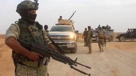 Four killed in ISIL suicide attack on Iraq party HQ