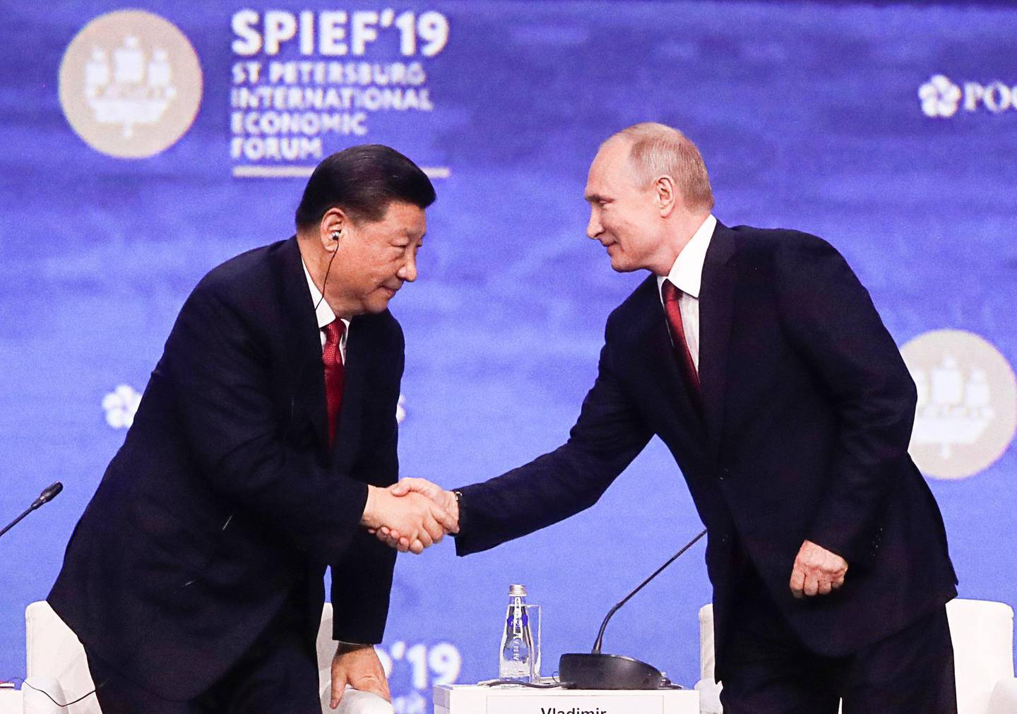 Russian President Vladimir Putin, right, shakes hands with Chinese President Xi Jinping at the St. Petersburg International Economic Forum in St. Petersburg, Russia, Friday, June 7, 2019. (Mikhail Metzel/TASS News Agency Pool Photo via AP)
