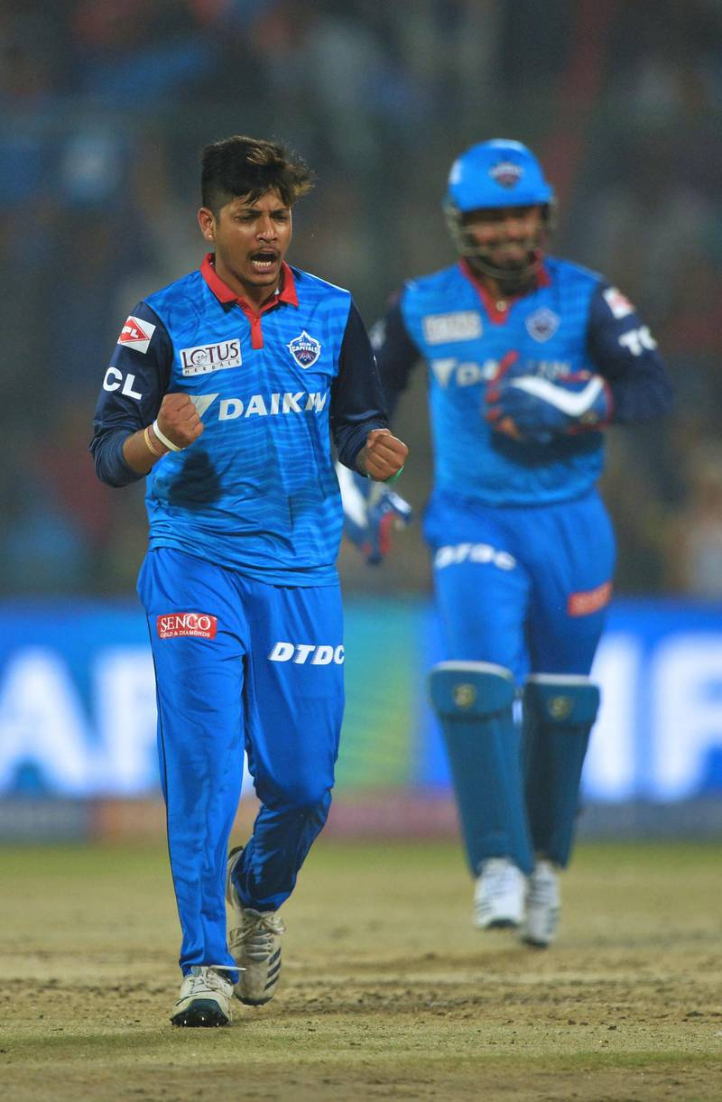 (FILES) In this file photo taken on April 20, 2019, Delhi Capitals bowler Sandeep Lamichhane (L) of Nepal celebrates after he dismissed Kings XI Punjab cricketer Chris Gayle during the 2019 Indian Premier League (IPL) Twenty20 cricket match between Delhi Capitals and Kings XI Punjab at the Feroz Shah Kotla cricket stadium in New Delhi.  The United States were bowled out for 35 by Nepal on February 12 and joined Zimbabwe in making the lowest total in a 50 over international. Nepal leg spinner Sandeep Lamichhane was wrecker-in-chief, taking six for 16 as the American side were finished off in 12 overs in the World Cup league two match in Kathmandu. - ----IMAGE RESTRICTED TO EDITORIAL USE - STRICTLY NO COMMERCIAL USE-----  / AFP / Sajjad HUSSAIN / ----IMAGE RESTRICTED TO EDITORIAL USE - STRICTLY NO COMMERCIAL USE-----