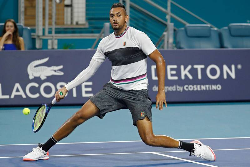 Mar 24, 2019; Miami Gardens, FL, USA; Nick Kyrgios of Australia hits a no-look volley against Dusan Lajovic of Serbia (not pictured) in the third round of the Miami Open at Miami Open Tennis Complex. Mandatory Credit: Geoff Burke-USA TODAY Sports