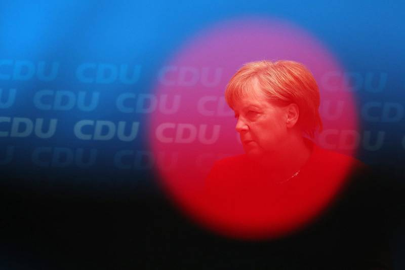 Angela Merkel, Germany's chancellor and leader of the Christian Democratic Union (CDU) party, pauses while speaking during a news conference at the CDU headquarters in Berlin, Germany, on Monday, June 18, 2018. Merkelhas accepted a two-week deadline over tougher migration policy set by Interior MinisterHorst Seehofer, who leads her Bavarian coalition partner, according to a person familiar with the matter. Photographer: Krisztian Bocsi/Bloomberg