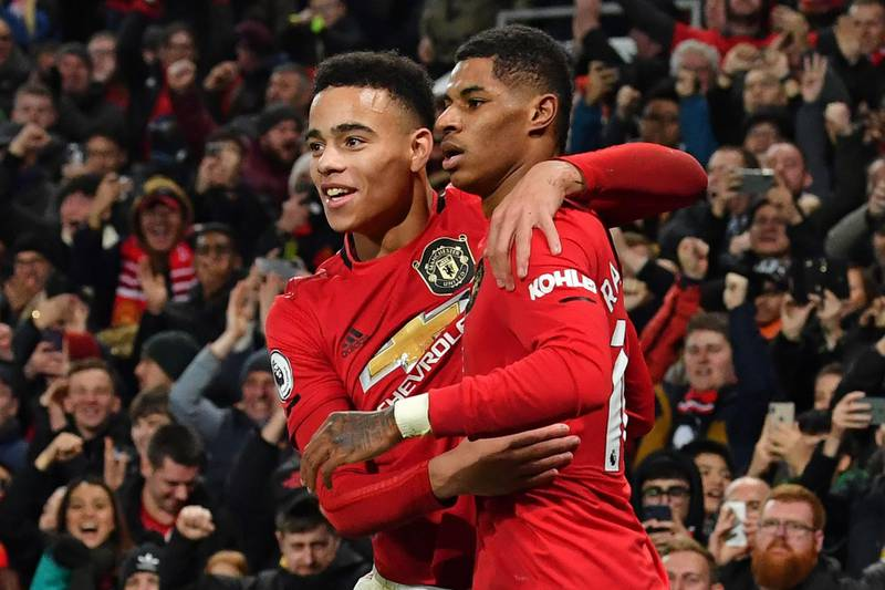 Manchester United's English striker Marcus Rashford (R) celebrates with Manchester United's English striker Mason Greenwood (L) after scoring their third goal during the English Premier League football match between Manchester United and Newcastle United at Old Trafford in Manchester, north west England, on December 26, 2019. RESTRICTED TO EDITORIAL USE. No use with unauthorized audio, video, data, fixture lists, club/league logos or 'live' services. Online in-match use limited to 120 images. An additional 40 images may be used in extra time. No video emulation. Social media in-match use limited to 120 images. An additional 40 images may be used in extra time. No use in betting publications, games or single club/league/player publications.  / AFP / Paul ELLIS / RESTRICTED TO EDITORIAL USE. No use with unauthorized audio, video, data, fixture lists, club/league logos or 'live' services. Online in-match use limited to 120 images. An additional 40 images may be used in extra time. No video emulation. Social media in-match use limited to 120 images. An additional 40 images may be used in extra time. No use in betting publications, games or single club/league/player publications.