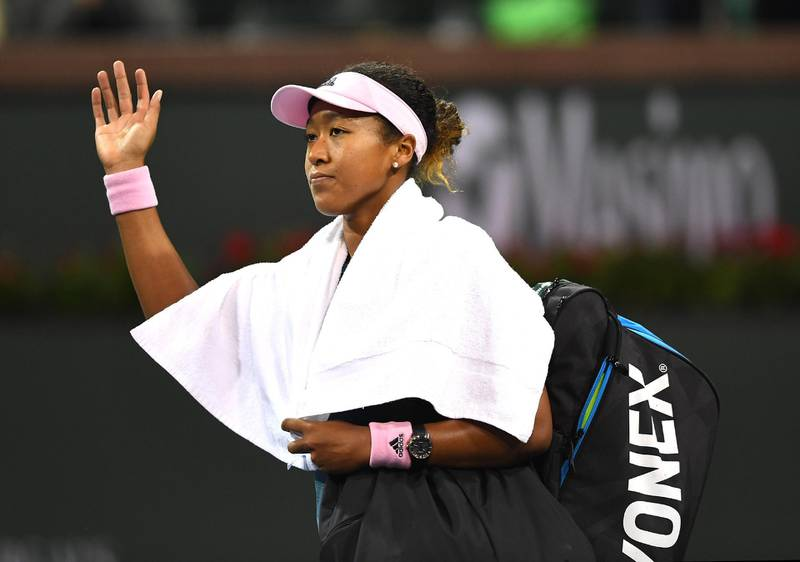 Mar 12, 2019; Indian Wells, CA, USA; Naomi Osaka (JPN) waves to fans while leaving the court after being her fourth round match against Belinda Bencic (not pictured) in the BNP Paribas Open at the Indian Wells Tennis Garden. Mandatory Credit: Jayne Kamin-Oncea-USA TODAY Sports