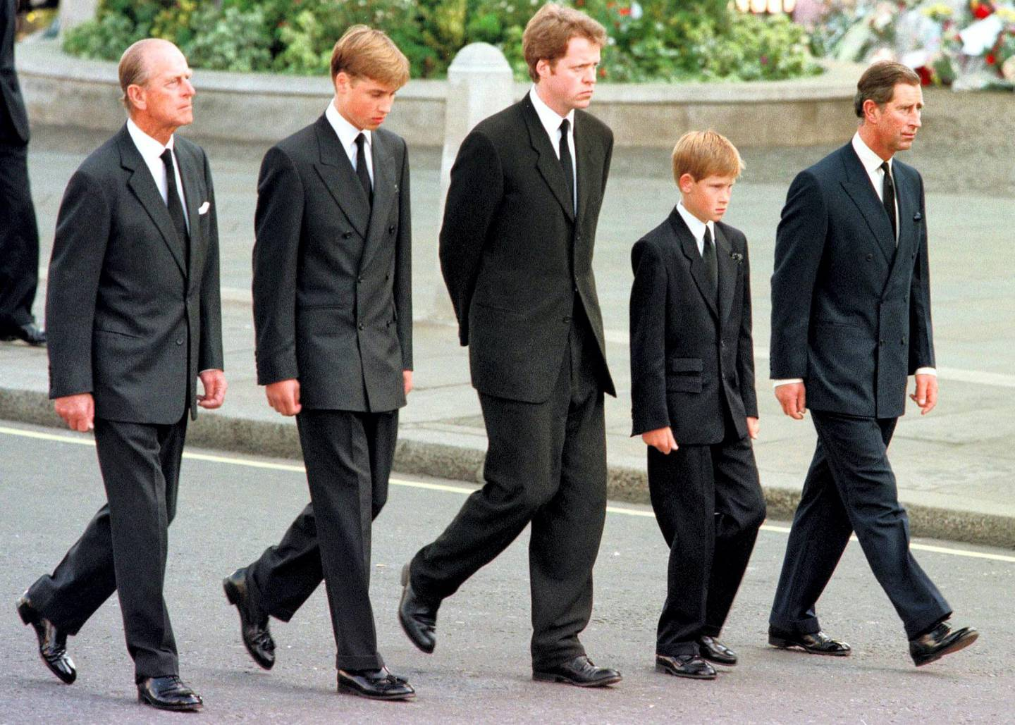 (L to R) The Duke of Edinburgh, Prince William, Earl Spencer, Prince Harry and Prince Charles walk outside Westminster Abbey during the funeral service for Diana, Princess of Wales, 06 September. Hundreds of thousands of mourners lined the streets of Central London to watch the funeral procession. The Princess died last week in a car crash in Paris. / AFP PHOTO / RTR/WPA POOL / JEFF J. MITCHELL