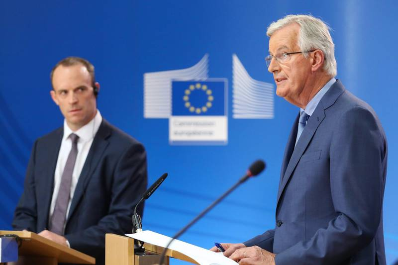Michel Barnier, chief negotiator for the European Union (EU), right, speaks as Dominic Raab, U.K. exiting the European Union (EU) secretary, listens during a news conference in Brussels, Belgium, on Thursday, July 26, 2018. Barnierrejected the central part of the U.K.'s proposal for a trade deal, in a blow to hopes of reaching an agreement by October. Photographer: Yuriko Nakao/Bloomberg