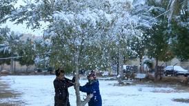 Snow brings rare joy to Iraqis amid political and social crisis