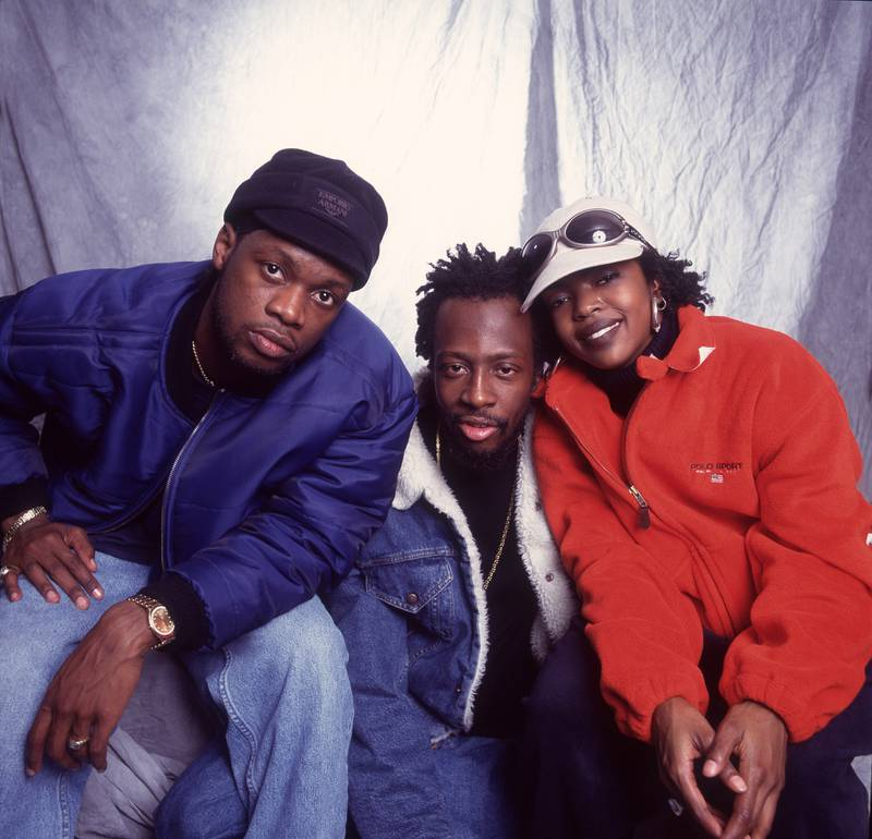 Portrait of American Hip Hop group Fugees as they pose backstage at the Allstate Arena, Rosemont, Illinois, September 2, 1997. Pictured are, from left, Pras, Wyclef Jean, and Lauryn Hill. (Photo by Paul Natkin/Getty Images)