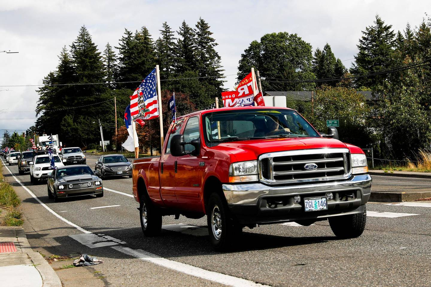People take part in a motorcade for supporting U.S. President Donald Trump, outside of Portland, Oregon, U.S., September 19, 2020. REUTERS/Shannon Stapleton