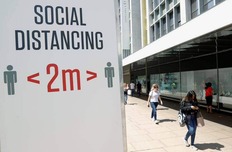 FILE PHOTO: A social distancing sign is seen in Oxford Street, as the outbreak of the coronavirus disease (COVID-19) continues, in London, Britain June 22, 2020. REUTERS/John Sibley/File Photo