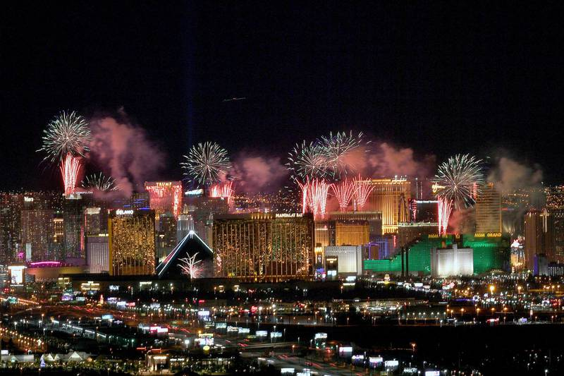 """LAS VEGAS, NEVADA - JANUARY 01: Fireworks illuminate the skyline over the Las Vegas Strip during an eight-minute-long pyrotechnics show put on by Fireworks by Grucci titled """"America's Party 2020"""" during a New Year's Eve celebration on January 1, 2020 in Las Vegas, Nevada. About 400,000 visitors gathered to watch more than 80,000 fireworks shoot from the rooftops of seven hotel-casinos to welcome the new year. (Photo by Bryan Steffy/Getty Images)"""