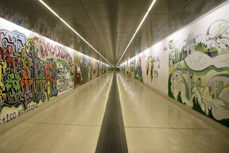 Murals adorn the walls of an empty subway station, in Milan, Friday, Feb. 28, 2020. Due to the COVID-19 virus outbreak in northern Italy, the bustling metropolis of Milan has resembled more of a ghost town lately, as workers stayed home and tourism has dwindled there, and other parts of Italy. (AP Photo/Luca Bruno)