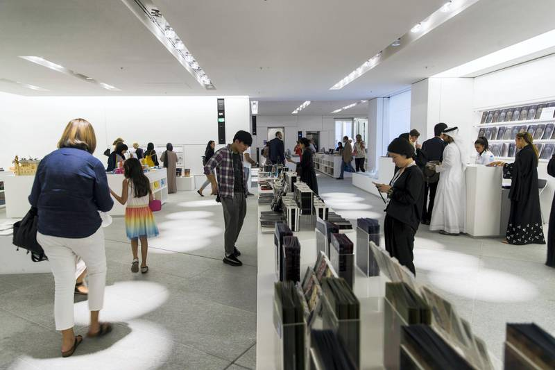 Abu Dhabi, United Arab Emirates, November 11, 2017:    Visitors in the boutique on opening day at the Louvre Abu Dhabi on Saadiyat Island in Abu Dhabi on November 11, 2017. Christopher Pike / The National  Reporter: James Langton, John Dennehy Section: News