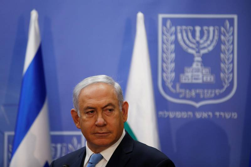 FILE PHOTO: Israeli Prime Minister Benjamin Netanyahu is seen during a news conference with Bulgarian President Rumen Radev, at the Prime Minister's office in Jerusalem, March 22, 2018. REUTERS/Ronen Zvulun/File Photo