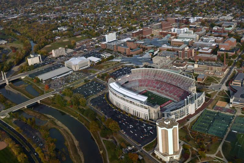 2B0A5JA Two U.S. Air Force F-16 Fighting Falcon fighter jets, assigned to the 180th Fighter Wing, fly over the Ohio State University football stadium during a routine training mission October 24, 2015 in Columbus, Ohio.