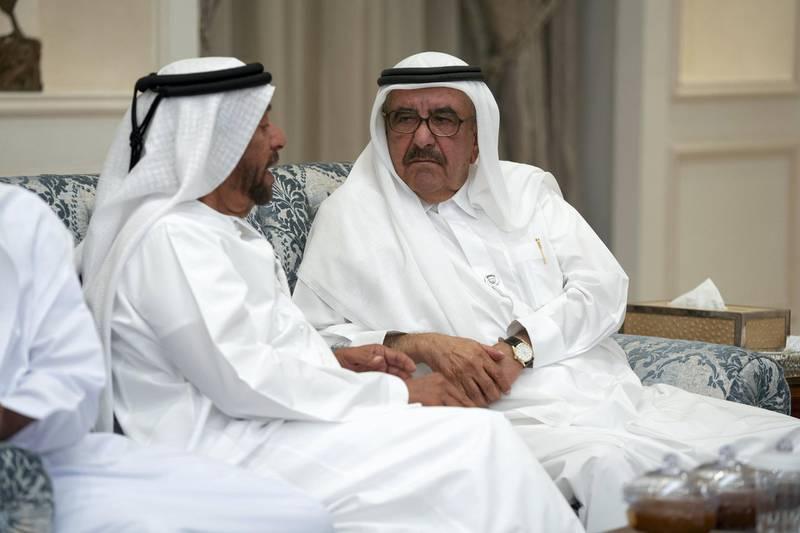 ABU DHABI, UNITED ARAB EMIRATES - November 21, 2019: HH Sheikh Hamdan bin Rashid Al Maktoum, Deputy Ruler of Dubai and UAE Minister of Finance (R), offers condolences to HH Sheikh Suroor bin Mohamed Al Nahyan (L), on the passing of the late HH Sheikh Sultan bin Zayed Al Nahyan, at Al Mushrif Palace.  ( Hamad Al Mansoori for the Ministry of Presidential Affairs ) ---