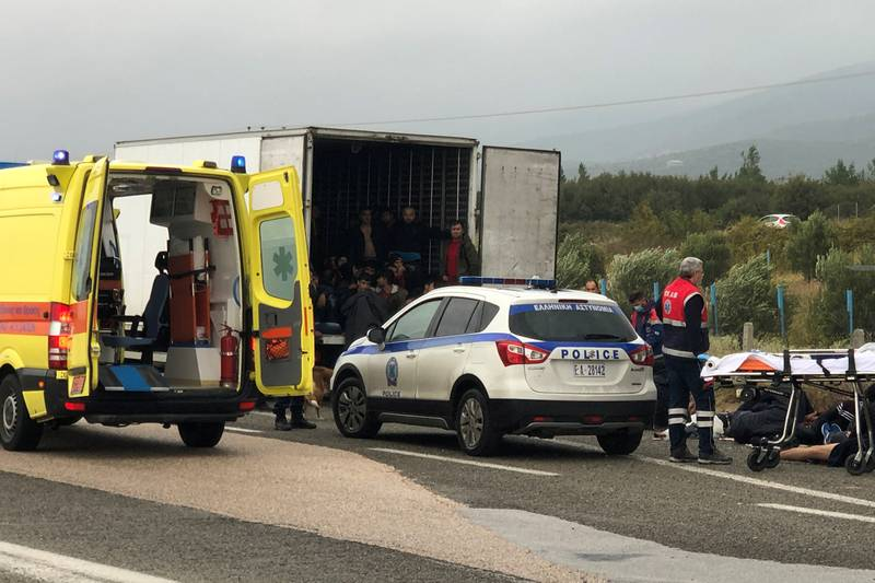 Migrants are seen inside a refrigerated truck found by police, after a check at a motorway near Xanthi, Greece, November 4, 2019. REUTERS/Stavros Karipidis NO RESALES. NO ARCHIVES