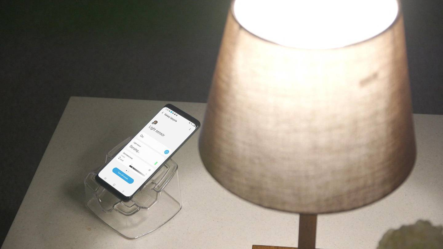 An older Galaxy smartphone is converted to a light sensor to measure the brightness level of the room. Users can easily set the device to automatically turn on the lights or the TV through SmartThings if the room becomes darker than the preset standard of light. Courtesy Samsung