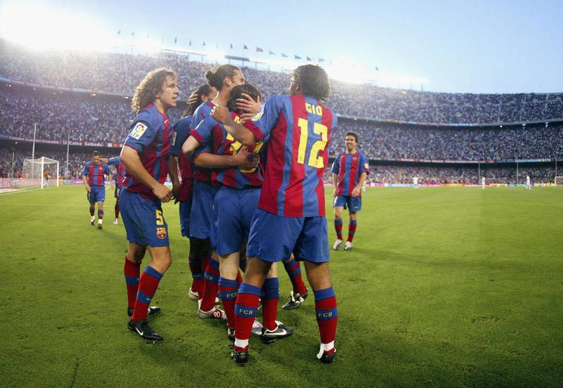 BARCELONA, SPAIN - MAY 1:  FC Barcelona players celebrate Leo Messi's goal during the La Liga match between FC Barcelona and Albacete on May 1, 2005 at Camp Nou stadium in Barcelona, Spain. (Photo by Luis Bagu/Getty Images)
