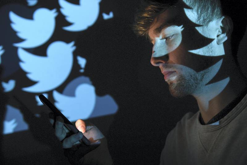 LONDON, ENGLAND - AUGUST 09:  In this photo illustration, the logo for the Twitter social media network is projected onto a man on August 09, 2017 in London, England. With around 328 million users worldwide, Twitter has gone from a small start-up in for the public 2006 to a broadcast tool of politicians and corporations in 2017.  (Photo by Leon Neal/Getty Images)