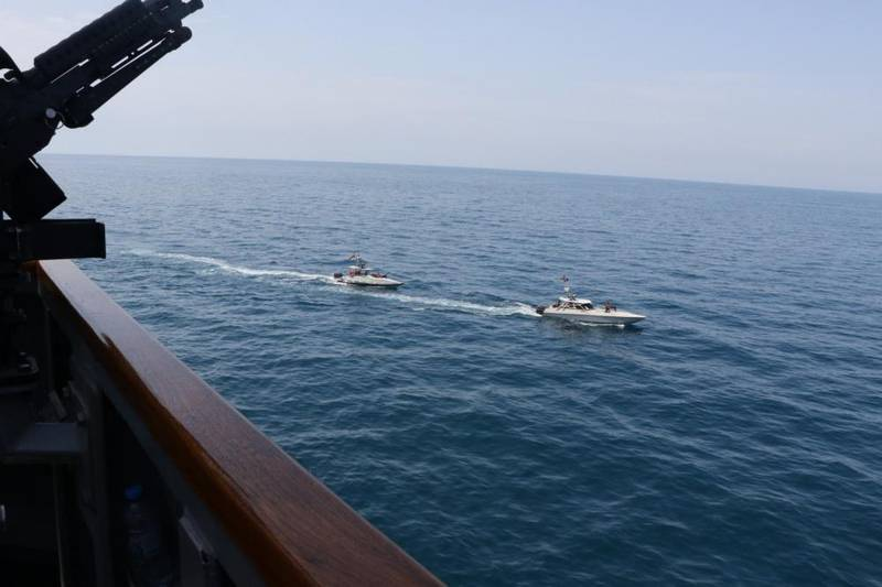 """(FILES)This US Navy file photo shows Iranian Islamic Revolutionary Guard Corps Navy (IRGCN) vessels conducting unsafe and unprofessional actions against the guided-missile destroyer USS Paul Hamilton (DDG 60) and other US military ships by crossing the ships' bows and sterns at close range while operating in international waters of the north Gulf on April 15, 2020.  Paul Hamilton is conducting joint interoperability operations in support of maritime security in the US 5th Fleet area of operations. US President Donald Trump said April 22, 2020 he had ordered the US military to attack and destroy any Iranian vessel that harasses US Navy ships. """"I have instructed the United States Navy to shoot down and destroy any and all Iranian gunboats if they harass our ships at sea,"""" Trump said on Twitter.  - RESTRICTED TO EDITORIAL USE - MANDATORY CREDIT """"AFP PHOTO /US NAVY/HANDOUT """" - NO MARKETING - NO ADVERTISING CAMPAIGNS - DISTRIBUTED AS A SERVICE TO CLIENTS  / AFP / Navy Office of Information / Handout / RESTRICTED TO EDITORIAL USE - MANDATORY CREDIT """"AFP PHOTO /US NAVY/HANDOUT """" - NO MARKETING - NO ADVERTISING CAMPAIGNS - DISTRIBUTED AS A SERVICE TO CLIENTS"""