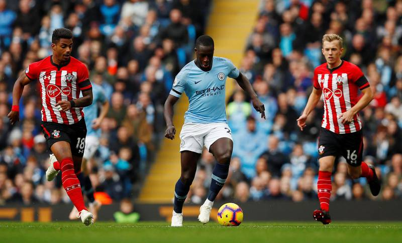 """Soccer Football - Premier League - Manchester City v Southampton - Etihad Stadium, Manchester, Britain - November 4, 2018  Manchester City's Benjamin Mendy in action with Southampton's James Ward-Prowse and Mario Lemina   Action Images via Reuters/Jason Cairnduff  EDITORIAL USE ONLY. No use with unauthorized audio, video, data, fixture lists, club/league logos or """"live"""" services. Online in-match use limited to 75 images, no video emulation. No use in betting, games or single club/league/player publications.  Please contact your account representative for further details."""