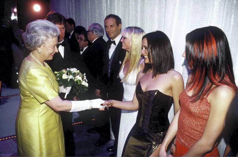 LONDON, UNITED KINGDOM - DECEMBER 01:  The Queen At The Royal Command Performance At The Victoria Palace Theatre On 1st December 1997 Shaking Hands With Pop Star Victoria Beckham (posh Spice) Of The Pop Band The Spice Girls.  (Photo by Tim Graham Picture Library/Getty Images)