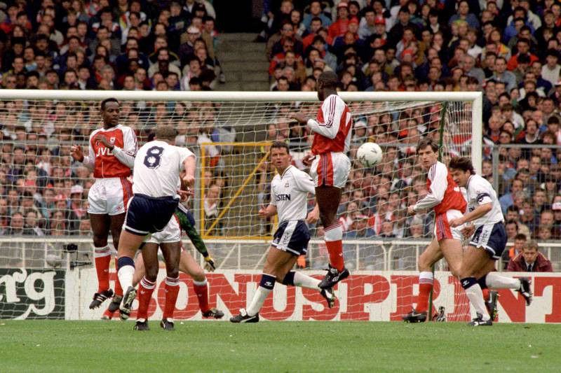 Tottenham Hotspur's Paul Gascoigne (left, white shirt, No 8) takes a free kick and scores against Arsenal, during their FA Cup semi-final football match at Wembley Stadium, in London.   (Photo by John Stillwell - PA Images/PA Images via Getty Images)