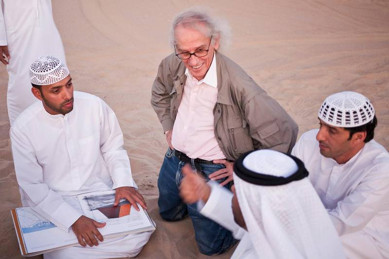 MADINAT ZAYED, UNITED ARAB EMIRATES,  October 10, 2012. Christo Yavacheff (center), a Bulgarian born instalation artistsnow living in New York, meets with Liwa residents Khalfan Al Qubasi (L) Saeed Al Falahi (R) and Obaid Al Mazrouei (front R) to discuss his plans to construct in Liwa a pyramid of 415,000 oil drums that will be bigger than the main pyramid of giza. (ANTONIE ROBERTSON / The National)