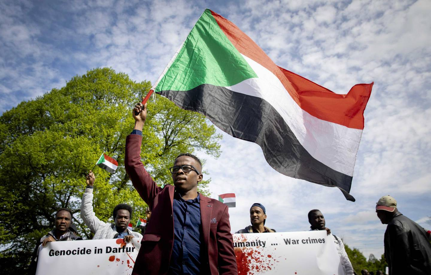 epa07529787 Sudanese refugees demonstrate at the Central Station in The Hague, The Netherlands, 26 April 2019. The protesters demanded that ousted Sudanese President Omar Al-Bashir should be trialed at the International Criminal Court (ICC).  EPA/BART MAAT