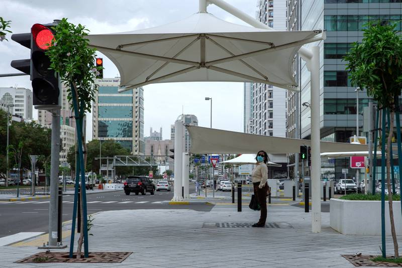 Abu Dhabi, United Arab Emirates, April 29, 2020.  A lady waits to cross Al Ain Street, Abu Dhabi Mall area.Victor Besa / The NationalSection:  NAFor:  Standalone/Stock Images