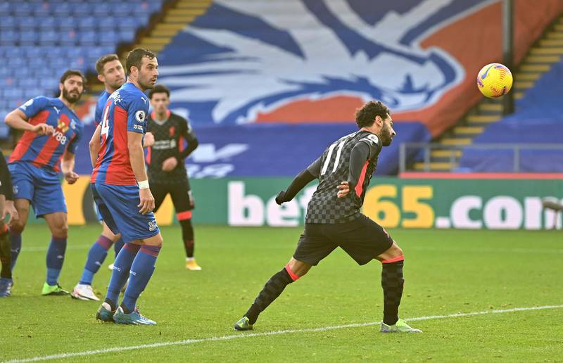 LONDON, ENGLAND - DECEMBER 19:  Mohamed Salah of Liverpool scores his team's sixth goal during the Premier League match between Crystal Palace and Liverpool at Selhurst Park on December 19, 2020 in London, England. The match will be played without fans, behind closed doors as a Covid-19 precaution. (Photo by Justin Setterfield/Getty Images)