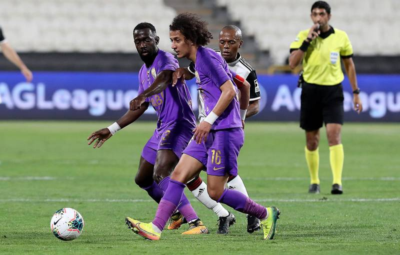 ABU DHABI, UNITED ARAB EMIRATES , March 14  – 2020 :-  Mohamed Abdelrahman (no 16) of Al Ain in action during the Arabian Gulf League football match between Al Jazira v Al Ain held at Mohamed bin Zayed Stadium in Abu Dhabi. (Pawan Singh / The National) For Sports. Story by John