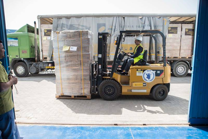 DUBAI, UNITED ARAB EMIRATES, 19 APRIL 2017. The World Food Programme loads trucks with food and supplies in response to the drought in Somalia at the International Humanitarian City Warehouses in Dubai. (Photo: Antonie Robertson/The National) ID: 74643. Journalist: Caline Malek. Section: National. *** Local Caption ***  AR_1904_World_Food_Programme-03.JPG