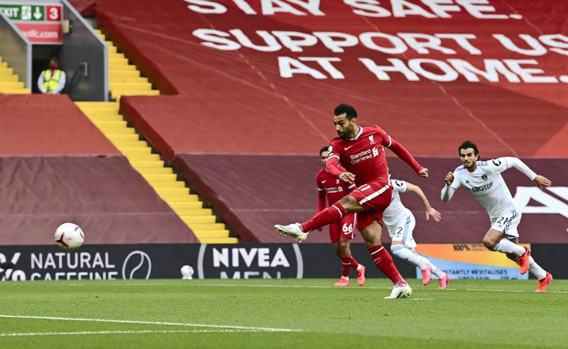 LIVERPOOL, ENGLAND - SEPTEMBER 12: Mohamed Salah of Liverpool scores a penalty for his team's first goal during the Premier League match between Liverpool and Leeds United at Anfield on September 12, 2020 in Liverpool, England. (Photo by Paul Ellis - Pool/Getty Images)